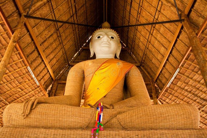 Tessuto di immagine del buddha di principio con bambù fotografie stock