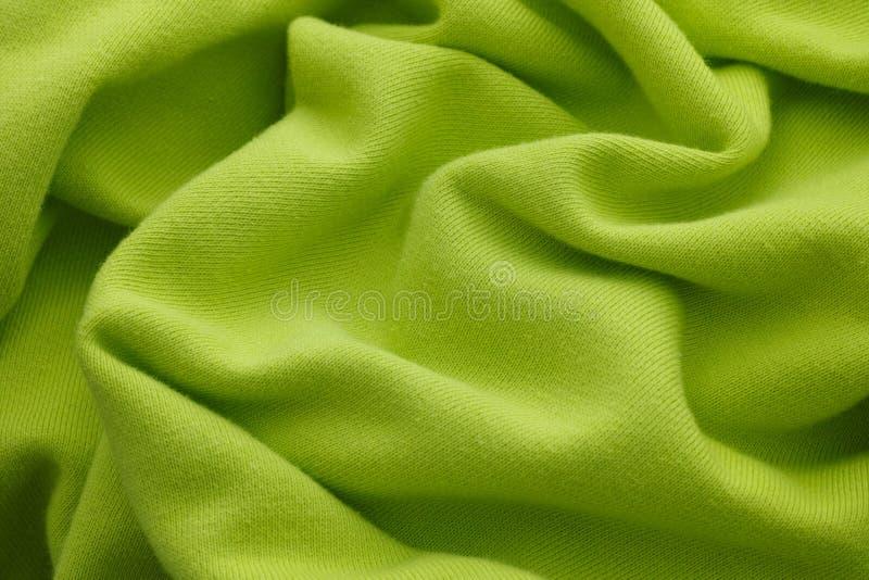 Tessuto di tessuto rugoso di calce verde immagini stock