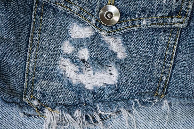 Tessuto e tasca delle blue jeans del primo piano fotografia stock libera da diritti
