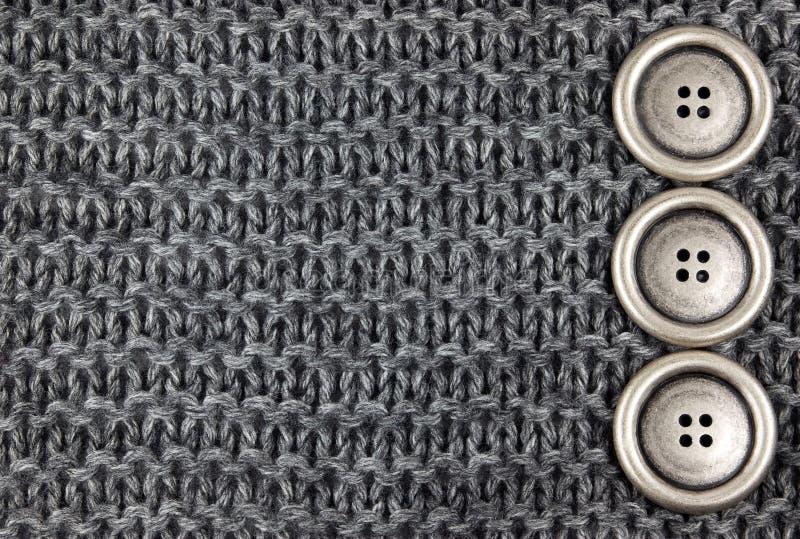 Tessuto e tasti lavorati a maglia immagine stock