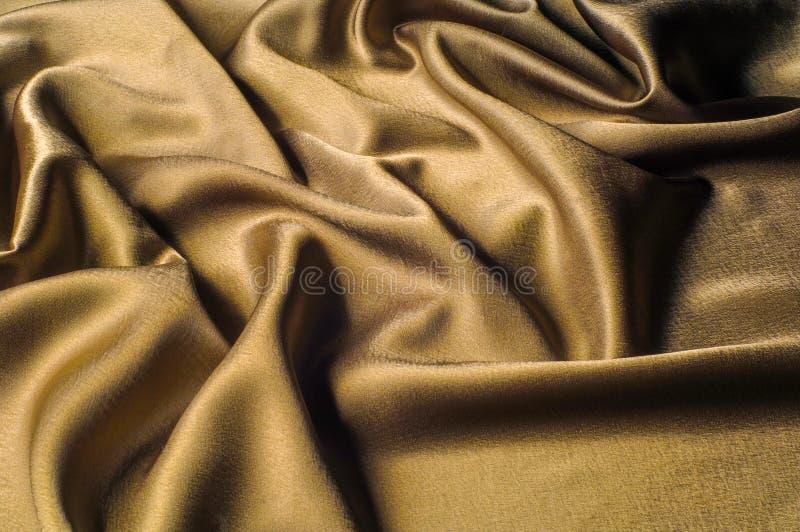 Tessuto fatto dell'oro metallico di splendore del filo del metallo del tessuto di seta Jus fotografie stock libere da diritti