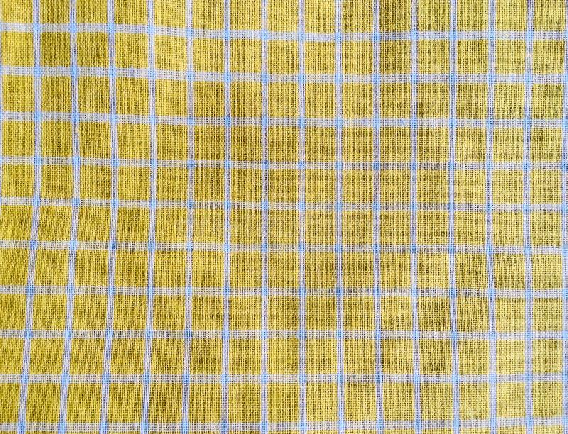 Tessuto giallo del controllo fotografia stock libera da diritti