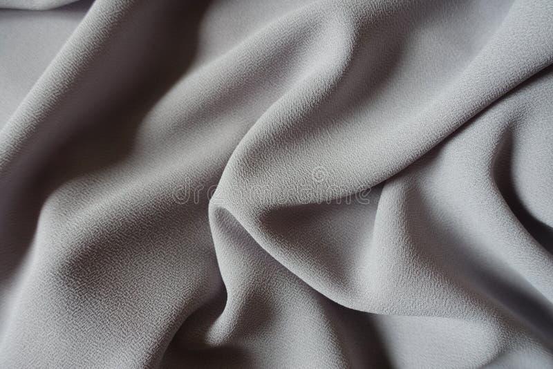 Tessuto grigio del georgette di crêpe in popolare molli fotografia stock libera da diritti