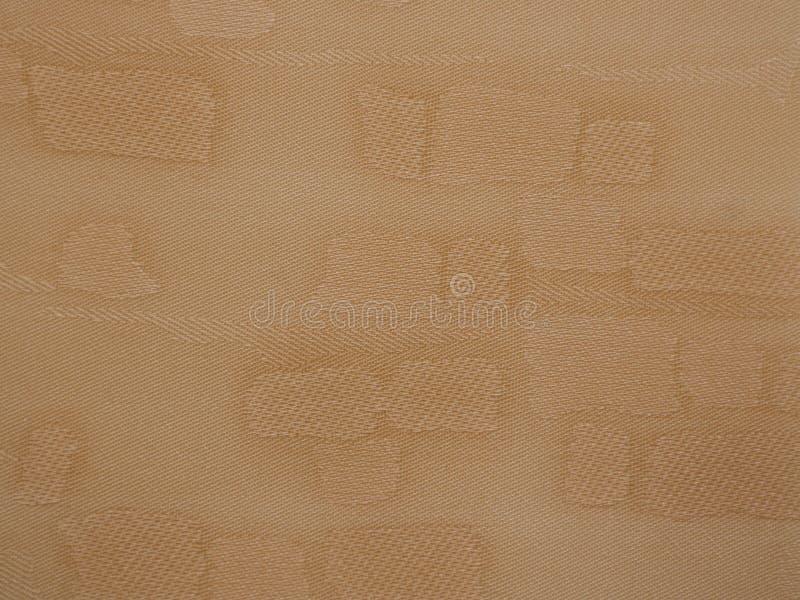 Tessuto marrone chiaro con le toppe fotografie stock