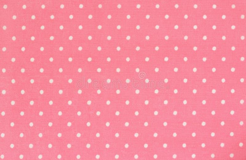 Tessuto rosa del punto di Polka fotografie stock libere da diritti