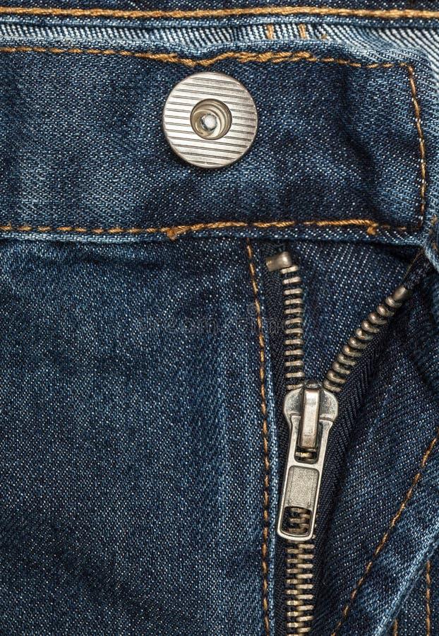 Tessuto - serie del tessuto: Jeans chiusura lampo e bottone immagini stock