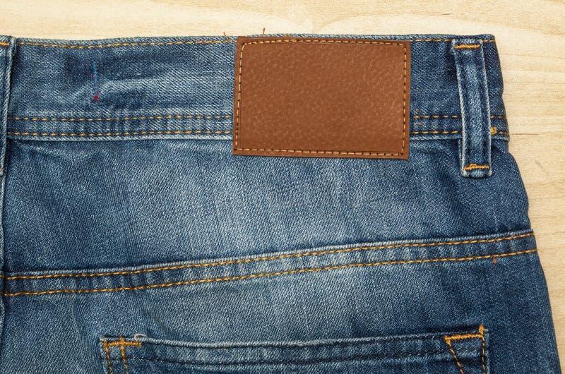 Tessuto - serie del tessuto: Jeans con l'etichetta di Emtpy immagine stock
