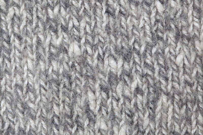 Tessuto - serie del tessuto - lana tricottata rustica immagine stock libera da diritti