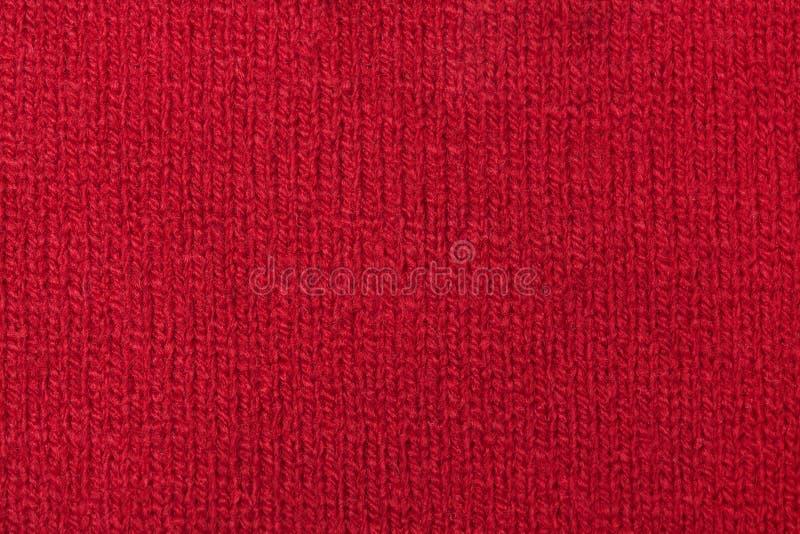 Tessuto - serie del tessuto - rosso tricottato lana fotografia stock libera da diritti
