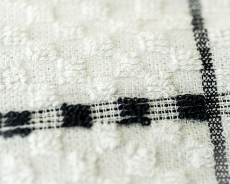 Tessuto strutturato bianco con le linee nere di accento immagine stock