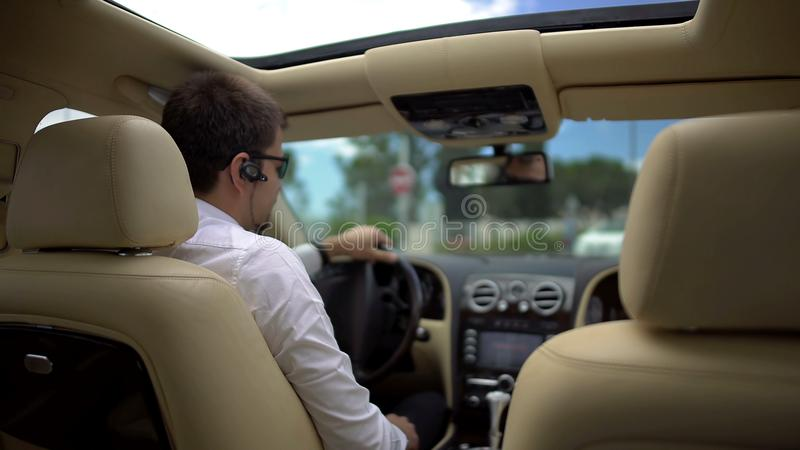 Test drive, business driver trying new luxury car, pleased with driving result. Stock footage stock photos