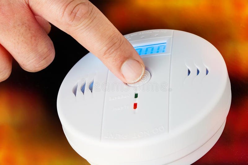Test of a smoke and fire alarm with carbon monoxide sensor capability stock images