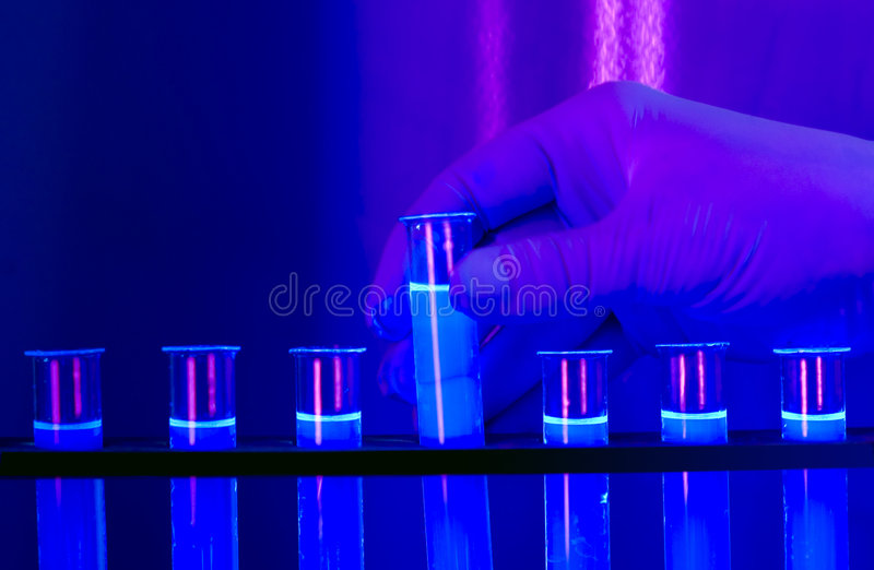 Test tubes. Chemical flasks full of fluorescent color liquid ready for analysis stock image