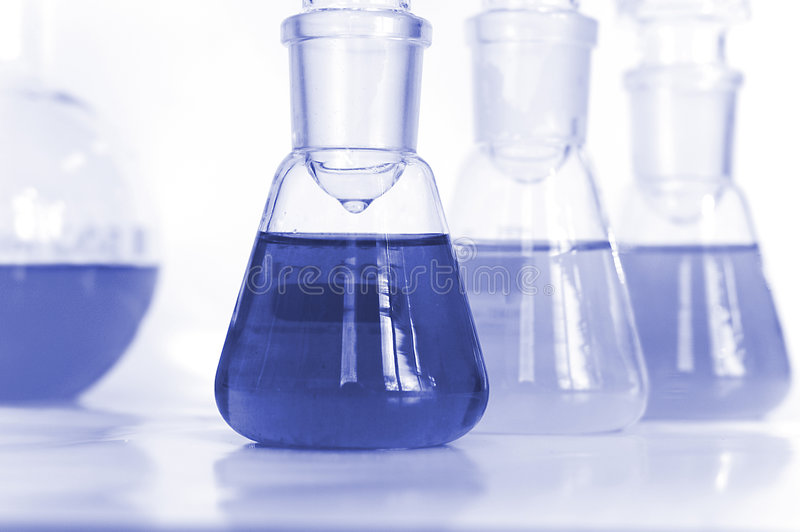 Test tubes. Chemical flasks full of blue color liquid ready for analysis see more stock images