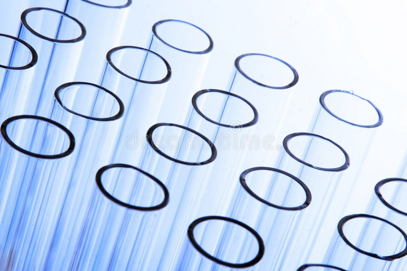 Test tubes. A bunch of test tubes in plain background royalty free stock photo