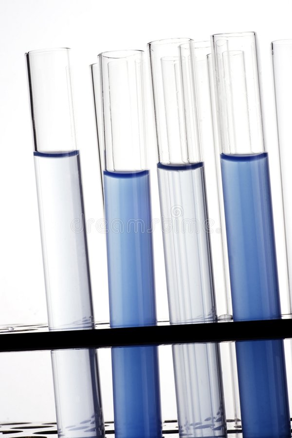 Test tubes. A bunch of test tubes in plain background stock photos