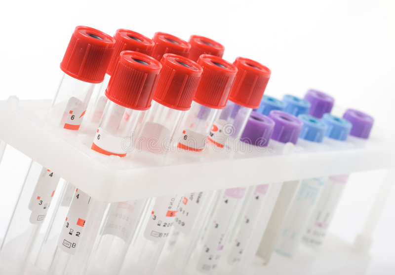 Test tubes. Multi-coloured test tubes isolated on the white stock photography