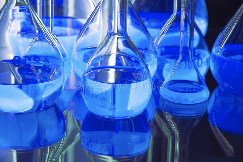 Test tubes in blue lights royalty free stock photography