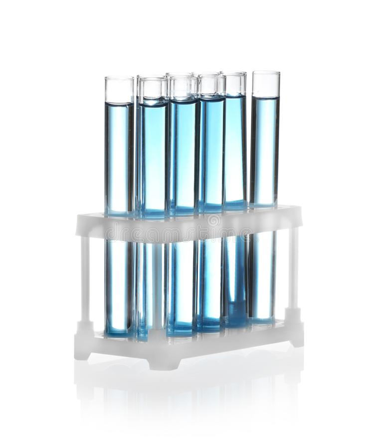 Test tubes with blue liquid isolated. Laboratory glassware stock images