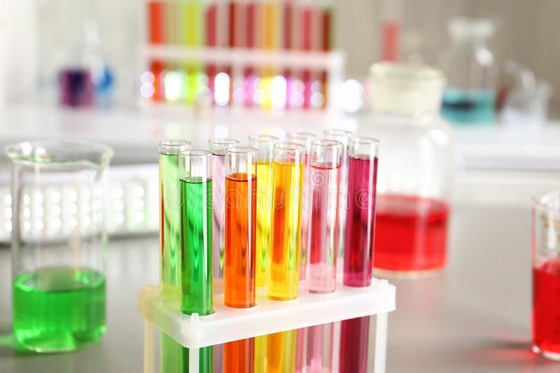 Test tubes with colorful samples in laboratory stock image