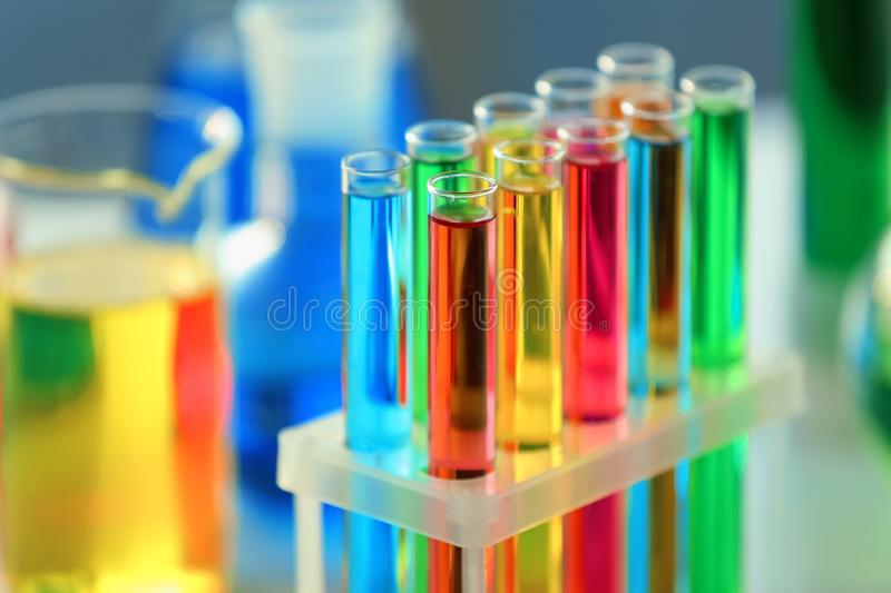 Test tubes with colorful samples in laboratory, closeup stock photography