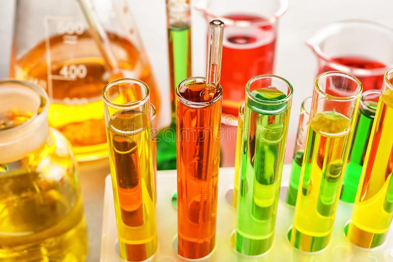 Test tubes with colorful samples in laboratory, closeup stock photo