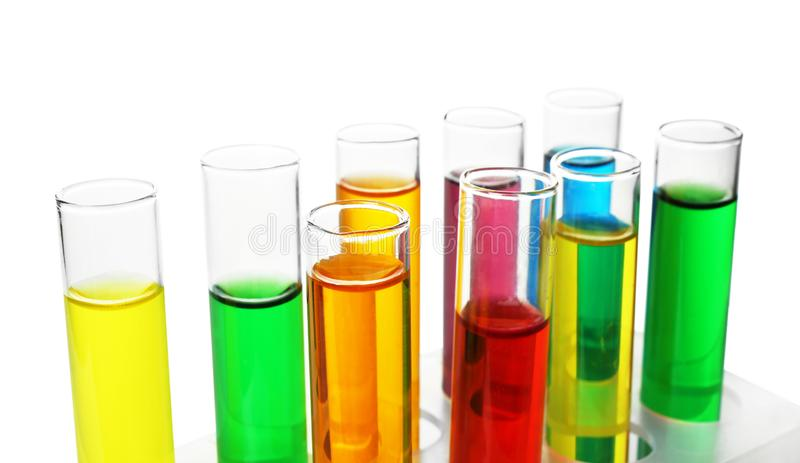 Test tubes with colorful samples on white background, closeup stock images