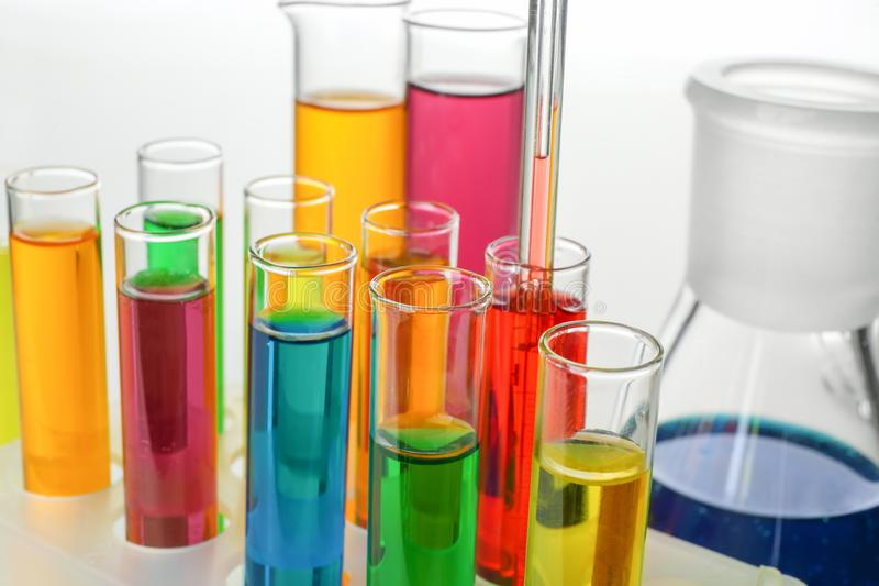 Test tubes with colorful samples on white background, closeup royalty free stock images