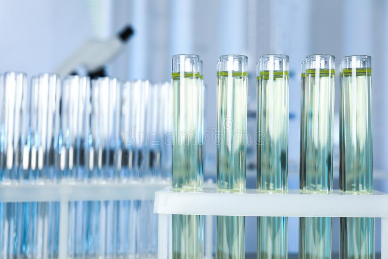 Test tubes with liquid on blurred background. Laboratory analysis stock images