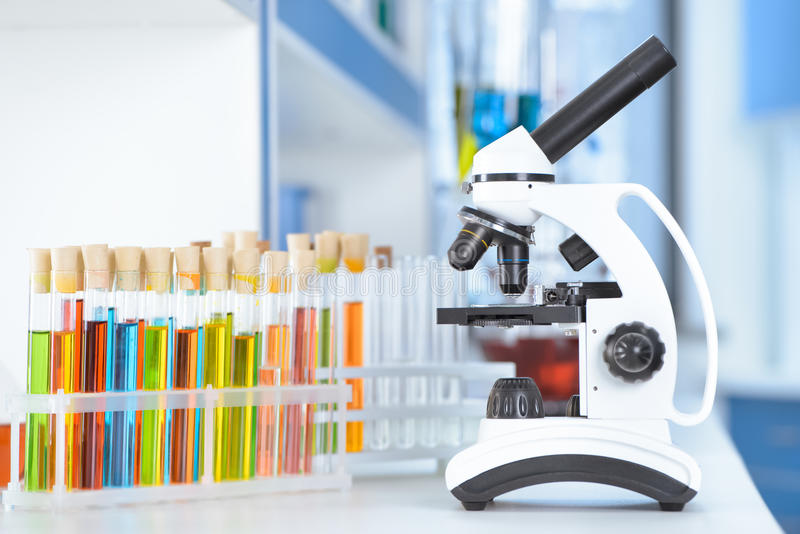 Test tubes and microscope on table. In laboratory royalty free stock photo