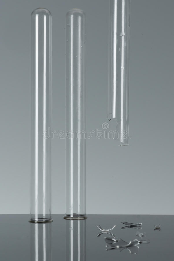Free Test Tubes, One Is Broken Royalty Free Stock Images - 14425579