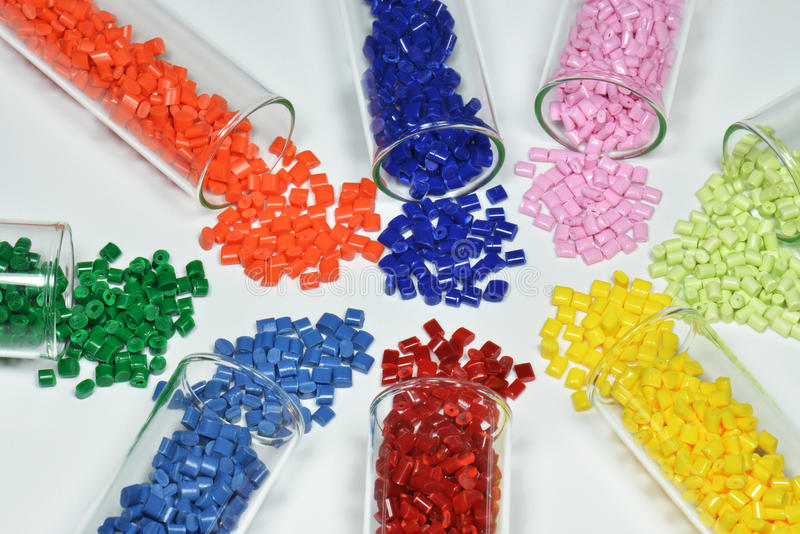 Test tubes with polymer resin. Test glasses with dyed polymer resins on white stock photos