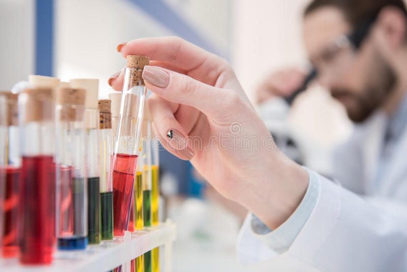 Test tubes with reagents stock images