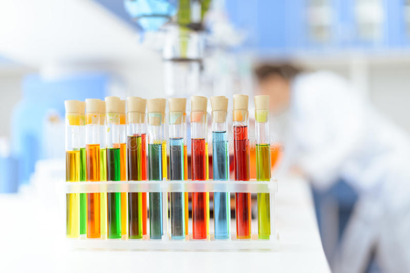 Test tubes with reagents on white table in laboratory. Close-up view of test tubes with reagents on white table in laboratory stock photo