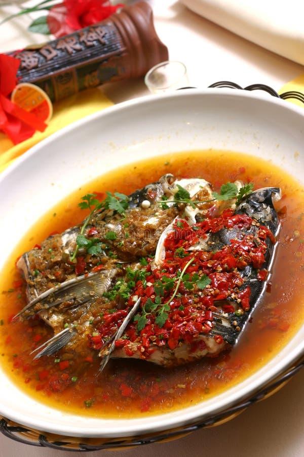 Testa cotta a vapore dei pesci con pepe tagliato immagine stock libera da diritti