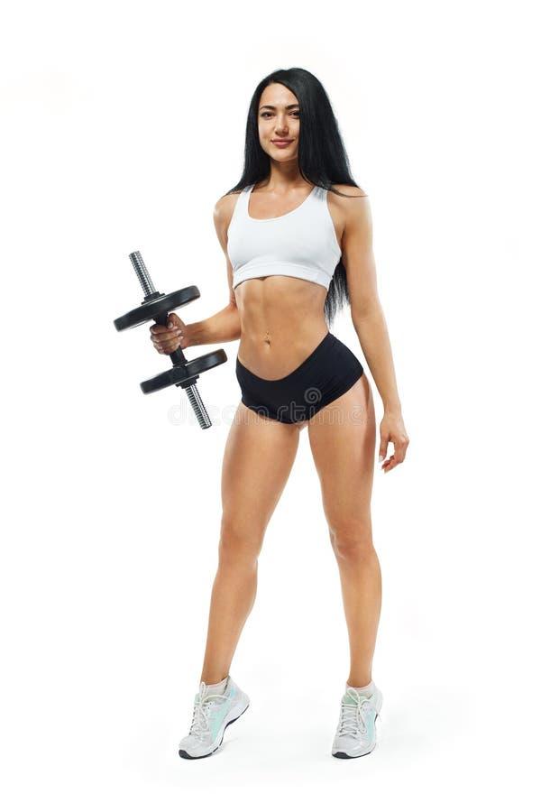 Testa di legno della tenuta dell'atleta e del culturista della donna di forma fisica Isolato su priorità bassa bianca fotografia stock libera da diritti