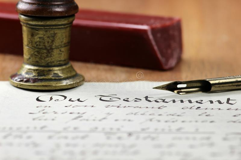 Testament. Old handwritten testament on desktop royalty free stock images