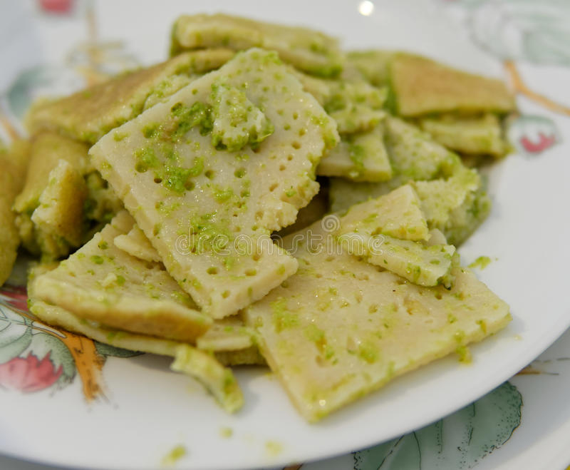 testaroli with pesto sauce, traditional italian recipe stock photo