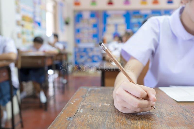 Teste o potencial dos estudantes tomando o conceito dos exames imagem de stock