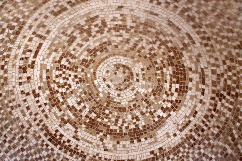 Teste padrão cerâmico romano velho do círculo do mosaico bege e marrom foto de stock royalty free