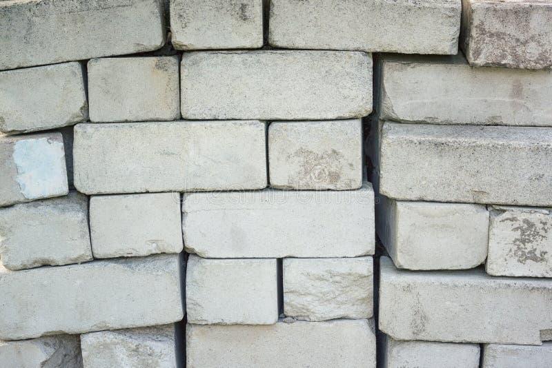 Teste padrão concreto velho do fundo da textura dos tijolos foto de stock