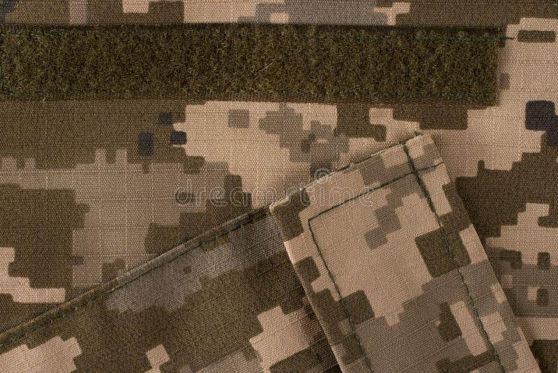 Teste padrão da camuflagem da tela com bolsos fotografia de stock
