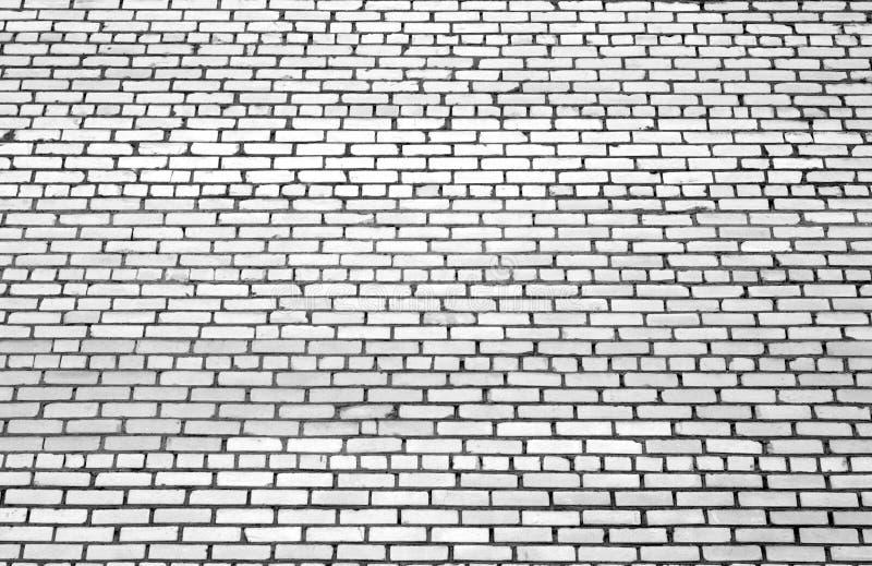 Teste padrão da parede de tijolo com efeito do borrão em preto e branco foto de stock royalty free