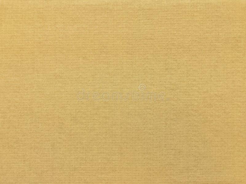 Teste padrão da superfície de pano do amarelo do ouro da textura da tela da lona, fundo de pano da tela fotografia de stock