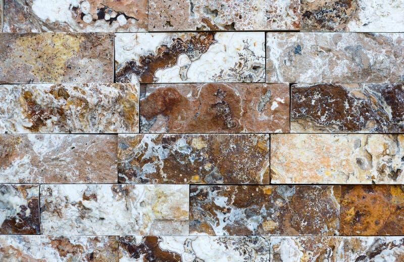 Teste padrão da textura e do fundo decorativos de pedra de mármore da parede de tijolo foto de stock