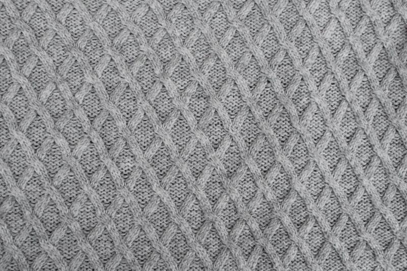 Teste padrão de confecção de malhas cinzento da tela de lãs imagens de stock royalty free