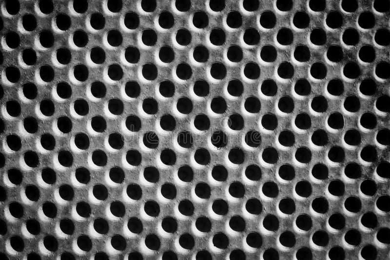 Teste padrão de furos do muro de cimento imagem de stock