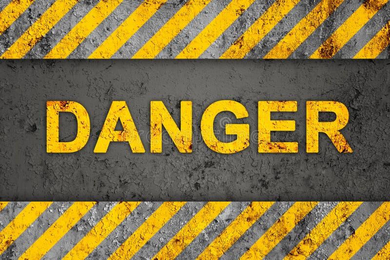 Teste padrão de Grunge com texto de advertência (perigo) imagem de stock royalty free