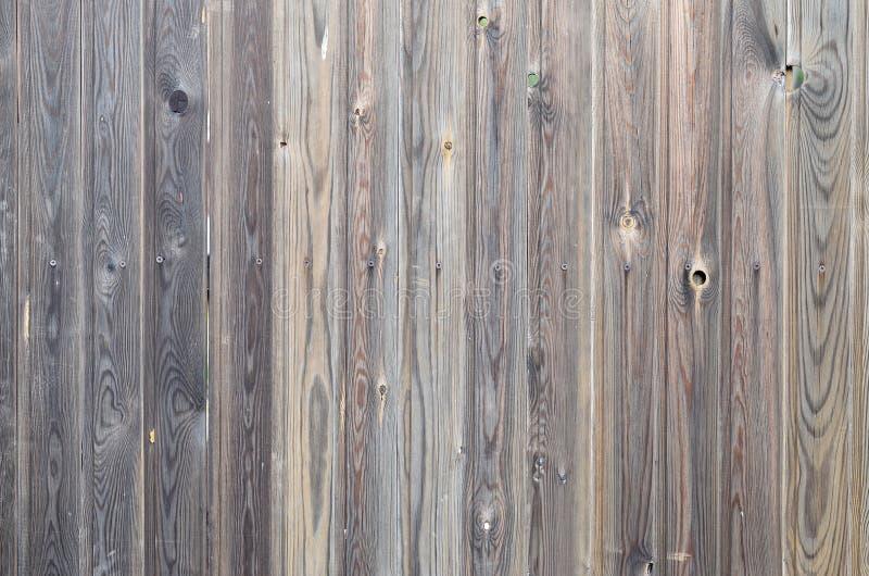 Teste padrão de madeira marrom escuro do painel do grunge velho com textura abstrata bonita da superfície da grão, fundo listrado fotografia de stock