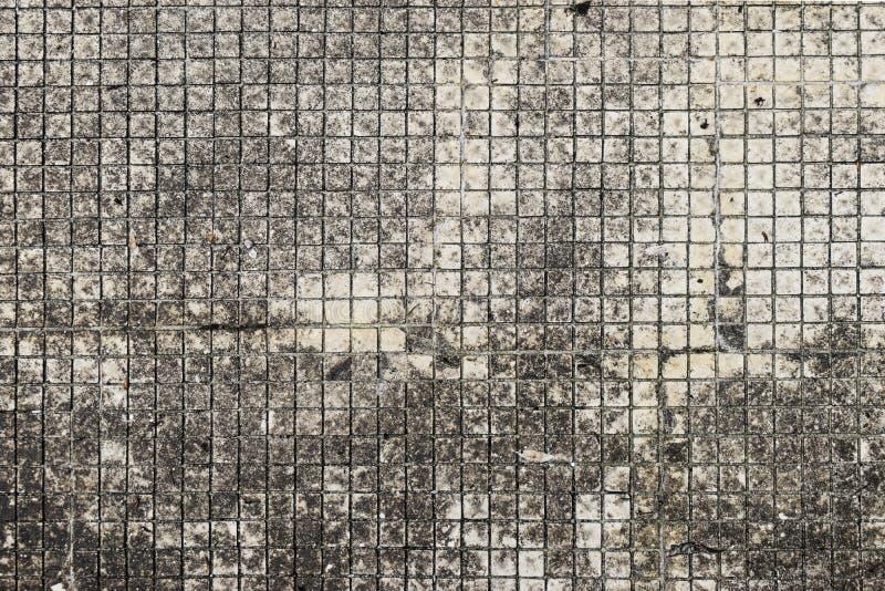 Teste padrão de mosaico envelhecido do grunge com a textura cinzenta útil para o fundo, os papéis de parede ou o espaço da cópia  fotos de stock royalty free
